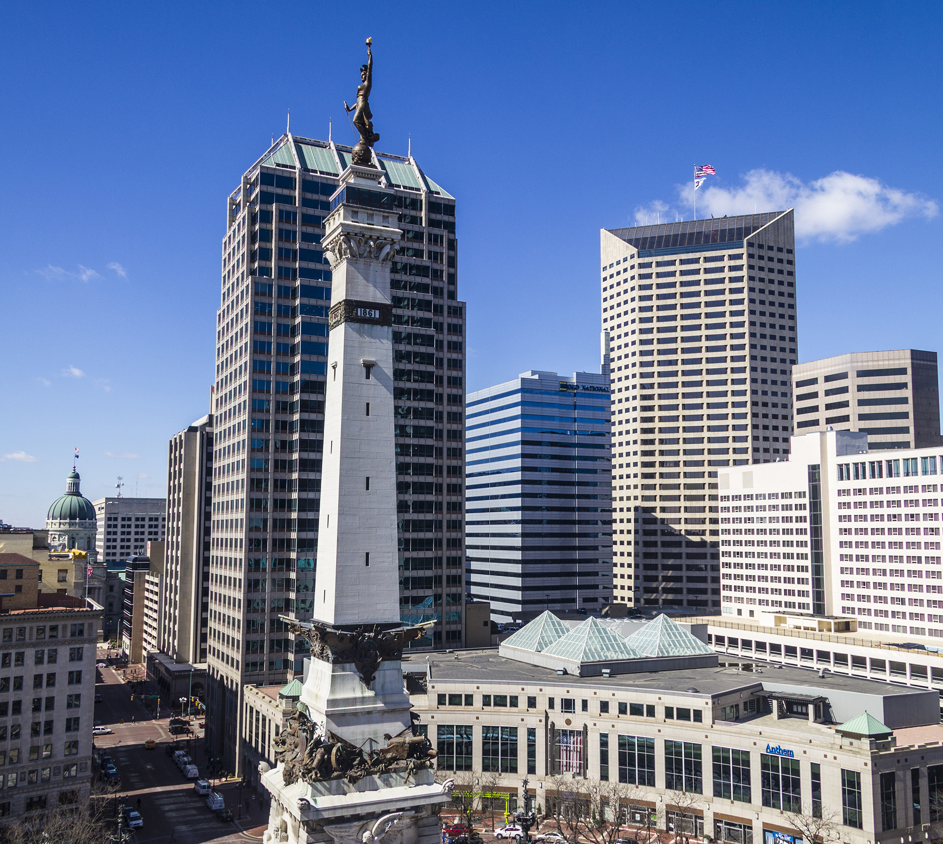 A view of downtown Indianapolis with a blue sky